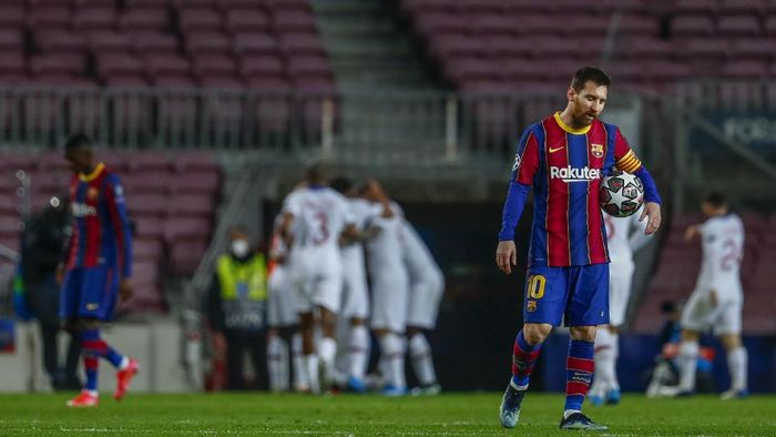 Barcelonas Lionel Messi reacts after PSGs Kylian Mbappe scored his sides first goal during the Champions League round of 16, first leg soccer match between FC Barcelona and Paris Saint-Germain at the Camp Nou stadium in Barcelona, Spain, Tuesday, Feb. 16, 2021. (AP Photo/Joan Monfort)