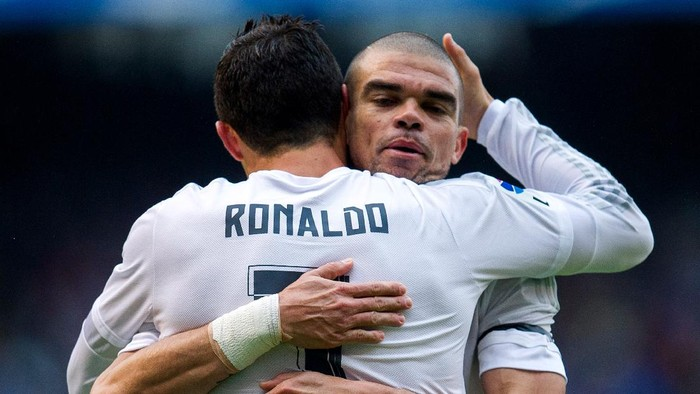 LA CORUNA, SPAIN - MAY 14:  Cristiano Ronaldo of Real Madrid celebrates with his teammate Pepe of Real Madrid after scoring the opening goal during the La Liga match between RC Deportivo La Coruna and Real Madrid CF at Riazor Stadium on May 14, 2016 in La Coruna, Spain.  (Photo by Juan Manuel Serrano Arce/Getty Images)