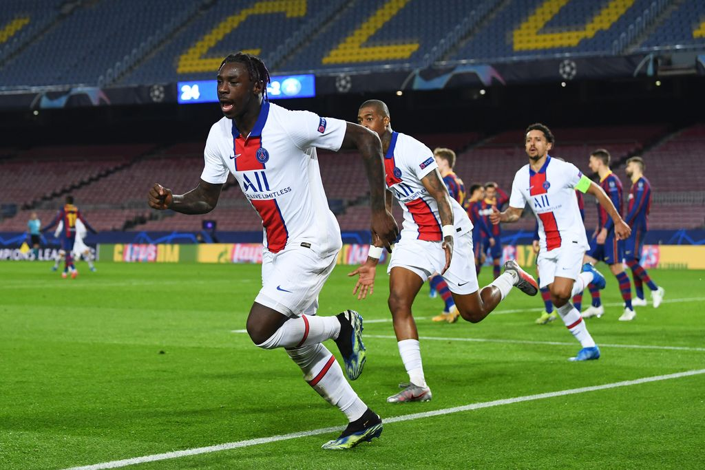 BARCELONA, SPAIN - FEBRUARY 16: Moise Keane of Paris Saint-Germain celebrates after scoring their side's third goal during the UEFA Champions League Round of 16 match between FC Barcelona and Paris Saint-Germain at Camp Nou on February 16, 2021 in Barcelona, Spain. Sporting stadiums around Spain remain under strict restrictions due to the Coronavirus Pandemic as Government social distancing laws prohibit fans inside venues resulting in games being played behind closed doors. (Photo by David Ramos/Getty Images)