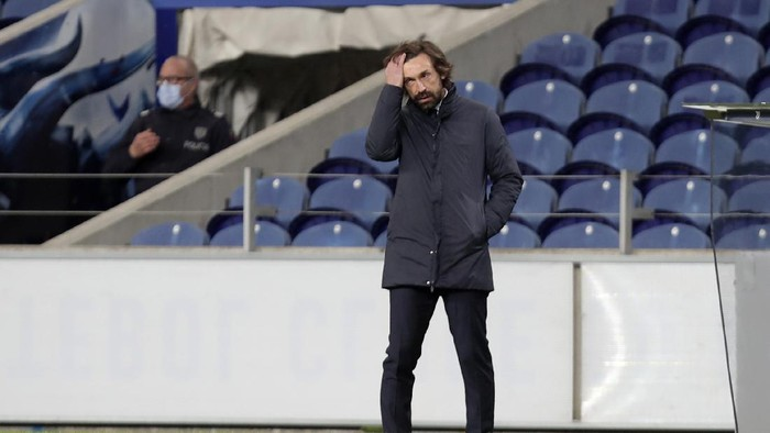 Juventus head coach Andrea Pirlo stands by the touchline during the Champions League round of 16, first leg, soccer match between FC Porto and Juventus at the Dragao stadium in Porto, Portugal, Wednesday, Feb. 17, 2021. (AP Photo/Luis Vieira)