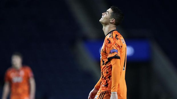 Juventus' Cristiano Ronaldo reacts during the Champions League round of 16, first leg, soccer match between FC Porto and Juventus at the Dragao stadium in Porto, Portugal, Wednesday, Feb. 17, 2021. (AP Photo/Luis Vieira)