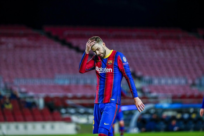 Barcelonas Gerard Pique reacts during the Champions League round of 16, first leg soccer match between FC Barcelona and Paris Saint-Germain at the Camp Nou stadium in Barcelona, Spain, Tuesday, Feb. 16, 2021. (AP Photo/Joan Monfort)
