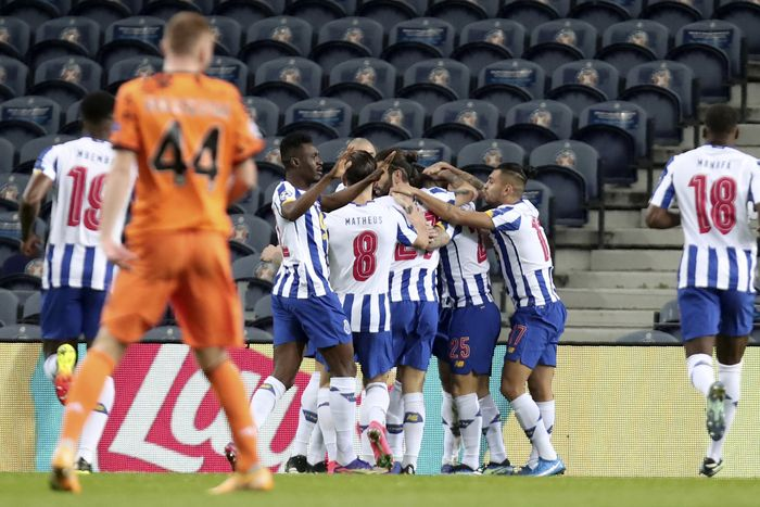 Porto players celebrate after Portos Mehdi Taremi scored the opening goal during the Champions League round of 16, first leg, soccer match between FC Porto and Juventus at the Dragao stadium in Porto, Portugal, Wednesday, Feb. 17, 2021. (AP Photo/Luis Vieira)