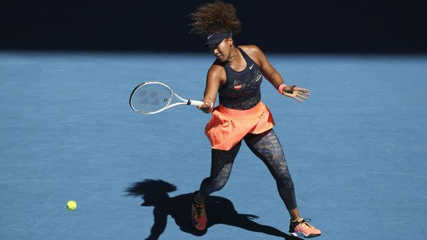 Japan's Naomi Osaka hits a forehand return to United States' Serena Williams during their semifinal match at the Australian Open tennis championship in Melbourne, Australia, Thursday, Feb. 18, 2021.(AP Photo/Hamish Blair)