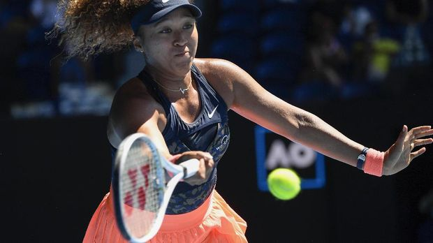 Japan's Naomi Osaka hits a forehand return to United States' Serena Williams during their semifinal match at the Australian Open tennis championship in Melbourne, Australia, Thursday, Feb. 18, 2021.(AP Photo/Andy Brownbill)