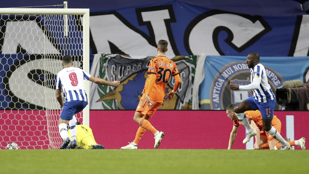 Porto's Moussa Marega, right, celebrates after scoring his side's second goal during the Champions League round of 16, first leg, soccer match between FC Porto and Juventus at the Dragao stadium in Porto, Portugal, Wednesday, Feb. 17, 2021. (AP Photo/Luis Vieira)