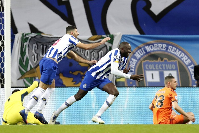 Portos Moussa Marega, center, celebrates with Mehdi Taremi, center left, after scoring his sides second goal during the Champions League round of 16, first leg, soccer match between FC Porto and Juventus at the Dragao stadium in Porto, Portugal, Wednesday, Feb. 17, 2021. (AP Photo/Luis Vieira)
