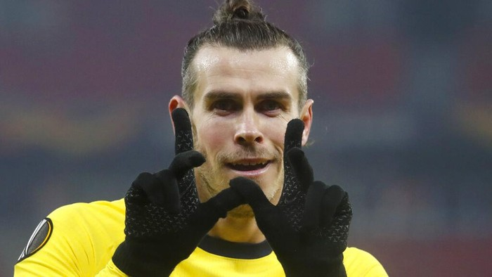 Tottenhams Gareth Bale celebrates after scoring his sides second goal during the Europa League round of 32, first leg, soccer match between Wolfsberger AC and Tottenham Hotspur at the Puskas Arena stadium in Budapest, Hungary, Thursday, Feb. 18, 2021. (AP Photo/Laszlo Balogh)