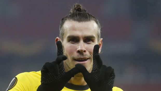 Tottenham's Gareth Bale celebrates after scoring his side's second goal during the Europa League round of 32, first leg, soccer match between Wolfsberger AC and Tottenham Hotspur at the Puskas Arena stadium in Budapest, Hungary, Thursday, Feb. 18, 2021. (AP Photo/Laszlo Balogh)