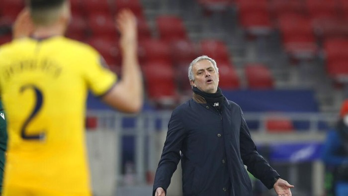 Tottenhams manager Jose Mourinho gestures during the Europa League round of 32, first leg, soccer match between Wolfsberger AC and Tottenham Hotspur at the Puskas Arena stadium in Budapest, Hungary, Thursday, Feb. 18, 2021. (AP Photo/Laszlo Balogh)