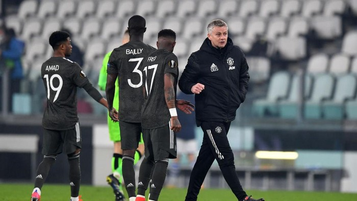 TURIN, ITALY - FEBRUARY 18: Fred of Manchester United and Ole Gunnar Solskjær, Manager of Manchester United interact following the UEFA Europa League Round of 32 match between Real Sociedad and Manchester United at Allianz Stadium on February 18, 2021 in Turin, Italy. Real Sociedad face Manchester United at a neutral venue in Turin behind closed doors after Spain imposed a ban on travellers arriving from the UK in an effort to prevent the spread of Covid-19 variants. (Photo by Valerio Pennicino/Getty Images)