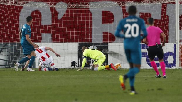 Red Star's Radovan Pankov, second left, scores an own goal past his goalkeeper during the Europa League round of 32 first leg soccer match between Red Star and AC Milan at the Rajko Mitic Stadium in Belgrade, Serbia, Thursday, Feb. 18, 2021. (AP Photo/Darko Vojinovic)