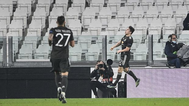 Manchester's Daniel James celebrates after scoring his side's 4th goal during the Europa League, round of 32, first-leg soccer match between Real Sociedad and Manchester United, at the Allianz Stadium in Turin, Italy, Thursday, Feb. 18, 2021. (Marco Alpozzi/LaPresse via AP)