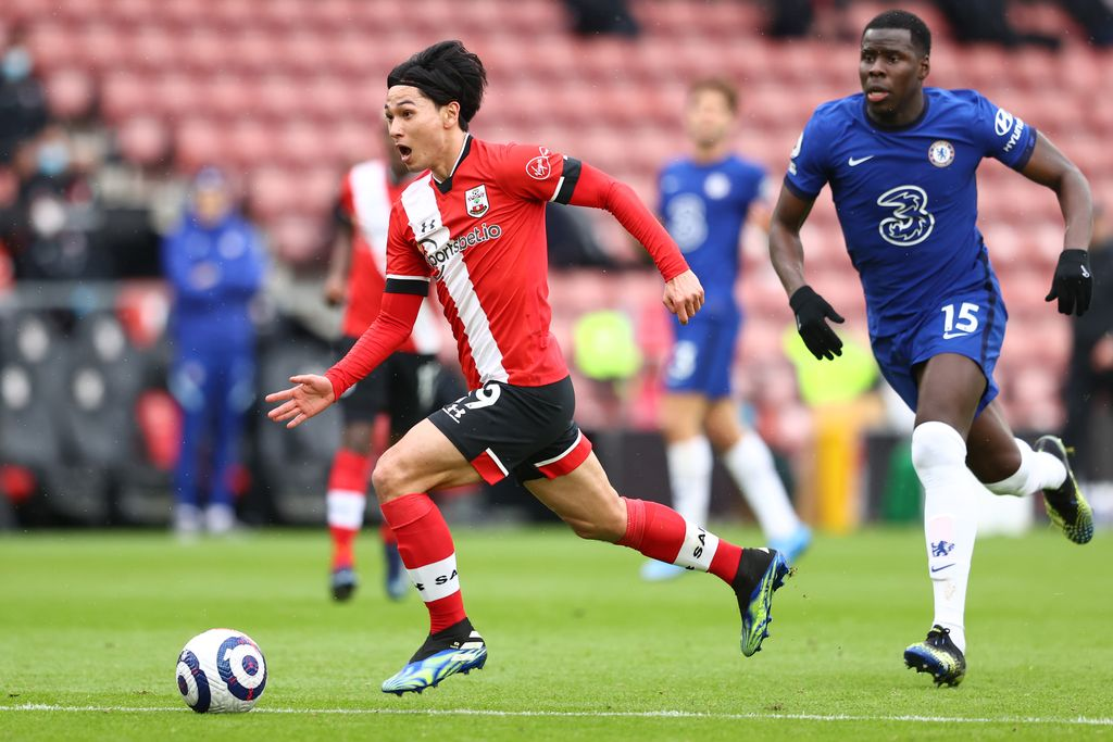 SOUTHAMPTON, ENGLAND - FEBRUARY 20: Takumi Minamino of Southampton on his way to scoring his team's first goal during the Premier League match between Southampton and Chelsea at St Mary's Stadium on February 20, 2021 in Southampton, England. Sporting stadiums around the UK remain under strict restrictions due to the Coronavirus Pandemic as Government social distancing laws prohibit fans inside venues resulting in games being played behind closed doors. (Photo by Michael Steele/Getty Images)