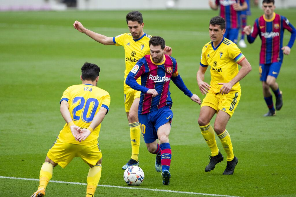 Barcelona's Lionel Messi scores from a penalty kick, during the Spanish La Liga soccer match between FC Barcelona and Cadiz at the Camp Nou stadium in Barcelona, Spain, Sunday, Feb. 21, 2021. (AP Photo/Joan Monfort)