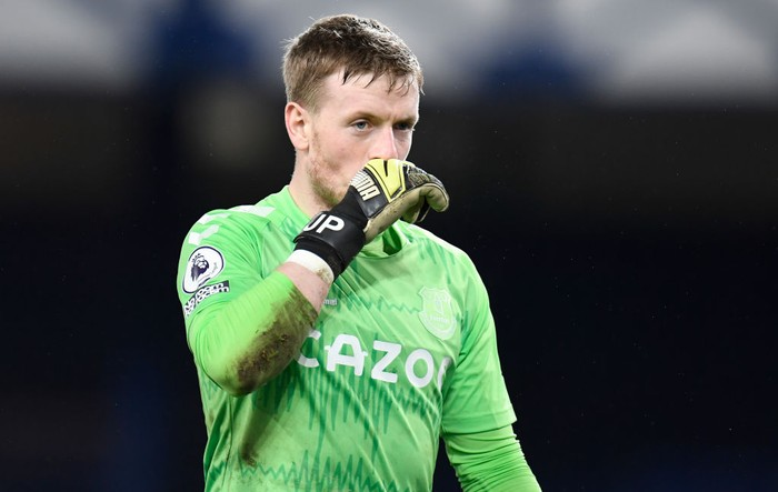 LIVERPOOL, ENGLAND - FEBRUARY 17: Jordan Pickford of Everton looks dejected after conceding his sides third goal during the Premier League match between Everton and Manchester City at Goodison Park on February 17, 2021 in Liverpool, England. Sporting stadiums around the UK remain under strict restrictions due to the Coronavirus Pandemic as Government social distancing laws prohibit fans inside venues resulting in games being played behind closed doors. (Photo by Peter Powell - Pool/Getty Images)