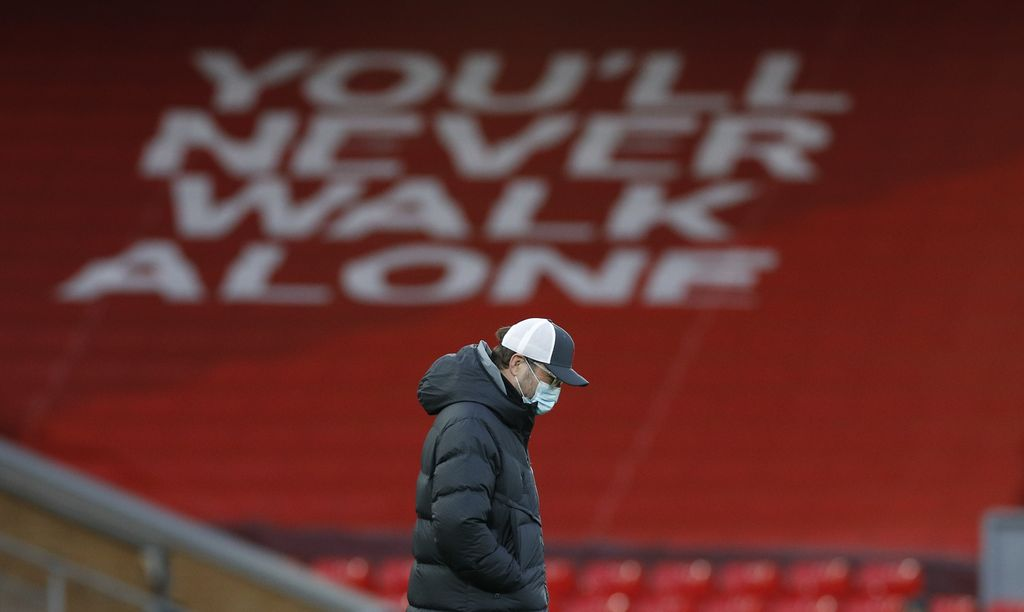 Liverpool's manager Jurgen Klopp walks on the pitch ahead of the English Premier League soccer match between Liverpool and Everton at Anfield in Liverpool, England, Saturday, Feb. 20, 2021. (Phil Noble/ Pool via AP)