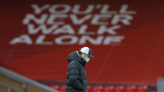Liverpools manager Jurgen Klopp walks on the pitch ahead of the English Premier League soccer match between Liverpool and Everton at Anfield in Liverpool, England, Saturday, Feb. 20, 2021. (Phil Noble/ Pool via AP)