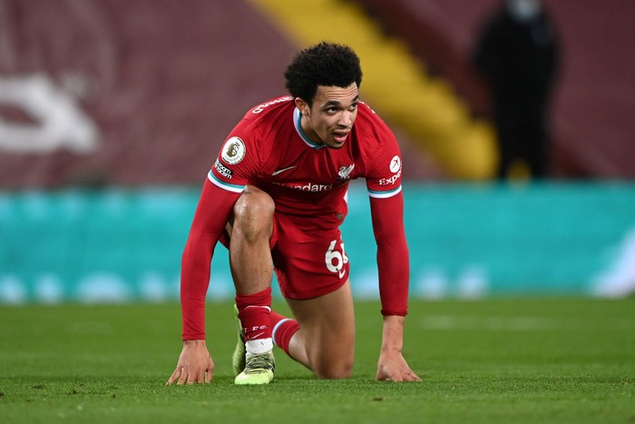 LIVERPOOL, ENGLAND - FEBRUARY 20: Trent Alexander-Arnold of Liverpool looks dejected after conceding a penalty during the Premier League match between Liverpool and Everton at Anfield on February 20, 2021 in Liverpool, England. Sporting stadiums around the UK remain under strict restrictions due to the Coronavirus Pandemic as Government social distancing laws prohibit fans inside venues resulting in games being played behind closed doors. (Photo by Laurence Griffiths/Getty Images)