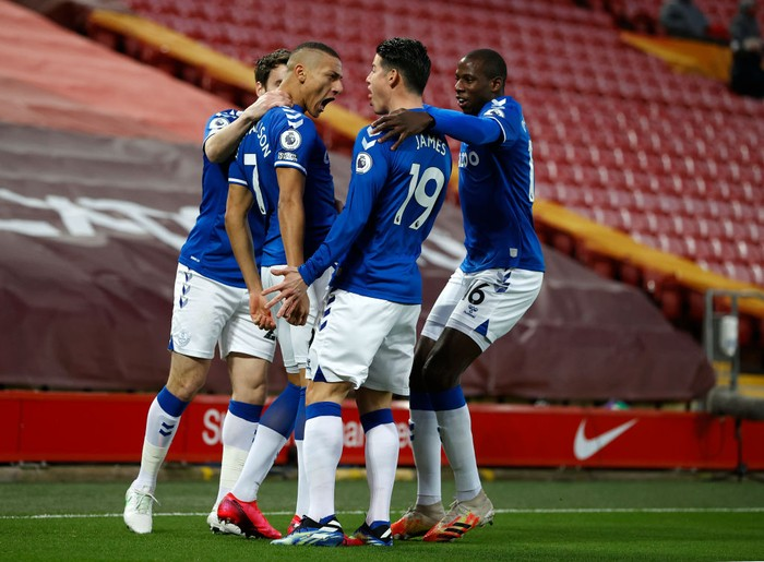 LIVERPOOL, ENGLAND - FEBRUARY 20: Richarlison of Everton celebrates with teammates Seamus Coleman, James Rodriguez and Abdoulaye Doucoure after scoring his teams first goal during the Premier League match between Liverpool and Everton at Anfield on February 20, 2021 in Liverpool, England. Sporting stadiums around the UK remain under strict restrictions due to the Coronavirus Pandemic as Government social distancing laws prohibit fans inside venues resulting in games being played behind closed doors. (Photo by Phil Noble - Pool/Getty Images)