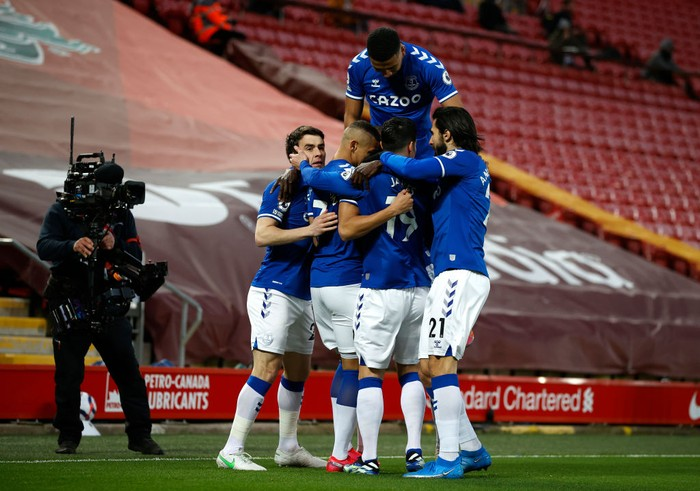 LIVERPOOL, ENGLAND - FEBRUARY 20: Richarlison of Everton celebrates with teammates Seamus Coleman, Mason Holgate, James Rodriguez and Andre Gomes  after scoring his teams first goal during the Premier League match between Liverpool and Everton at Anfield on February 20, 2021 in Liverpool, England. Sporting stadiums around the UK remain under strict restrictions due to the Coronavirus Pandemic as Government social distancing laws prohibit fans inside venues resulting in games being played behind closed doors. (Photo by Phil Noble - Pool/Getty Images)