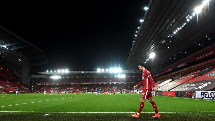 LIVERPOOL, ENGLAND - FEBRUARY 20: Curtis Jones of Liverpool leaves the pitch as he is substituted off during the Premier League match between Liverpool and Everton at Anfield on February 20, 2021 in Liverpool, England. Sporting stadiums around the UK remain under strict restrictions due to the Coronavirus Pandemic as Government social distancing laws prohibit fans inside venues resulting in games being played behind closed doors. (Photo by Paul Ellis - Pool/Getty Images)