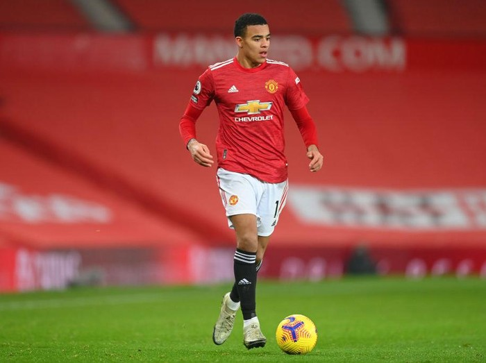 MANCHESTER, ENGLAND - DECEMBER 29: Mason Greenwood of Manchester United in action during the Premier League match between Manchester United and Wolverhampton Wanderers at Old Trafford on December 29, 2020 in Manchester, England. The match will be played without fans, behind closed doors as a Covid-19 precaution. (Photo by Michael Regan/Getty Images)