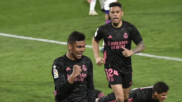 Real Madrids Casemiro celebrates after scoring his sides opening goal during the Spanish La Liga soccer match between Valladolid and Real Madrid at the Jose Zorrila stadium in Valladolid, Spain, Saturday, Feb. 20, 2021. (AP Photo/Alvaro Barrientos)