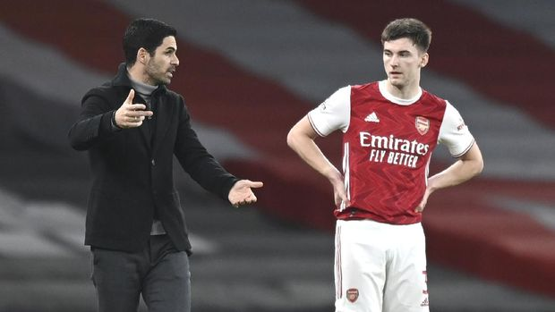 Arsenal's manager Mikel Arteta, left, speaks to Arsenal's Kieran Tierney during the English Premier League soccer match between Arsenal and Manchester City at the Emirates stadium in London, England, Sunday, Feb. 21, 2021. (Shaun Botterill/Pool via AP)