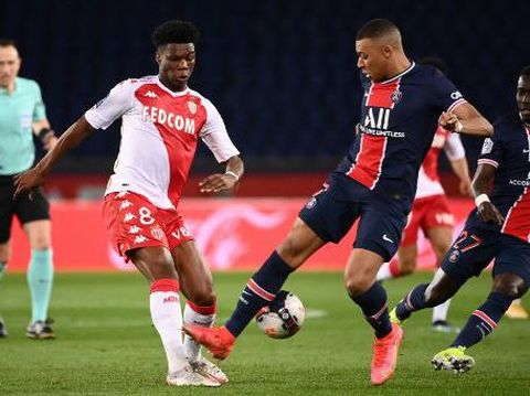 Paris Saint-Germain's French forward Kylian Mbappe (R) fights for the ball with Monaco's French midfielder Aurelien Tchouameni during the French L1 football match between Paris-Saint Germain (PSG) and AS Monaco FC at The Parc des Princes Stadium in Paris on February 21, 2021. (Photo by FRANCK FIFE / AFP)
