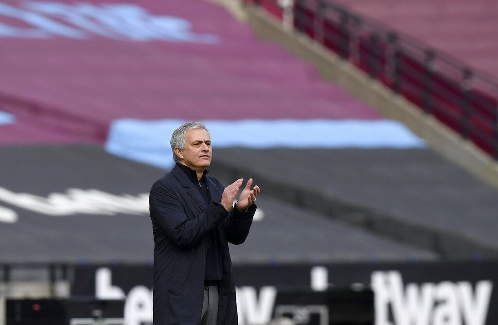 Tottenham's manager Jose Mourinho applauds during the English Premier League soccer match between West Ham United and Tottenham at the London Stadium in London, Saturday, Feb. 21, 2021. (Neil Hall/Pool via AP)