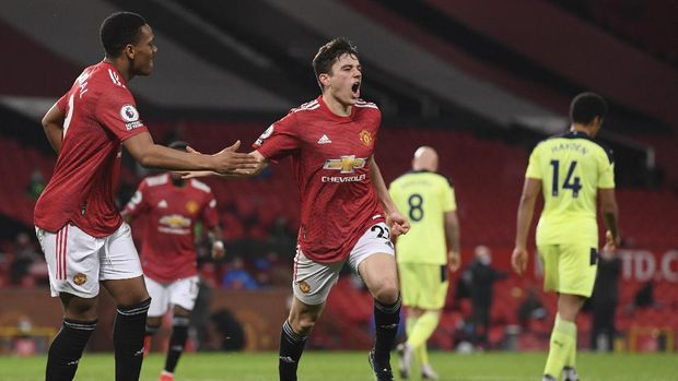Manchester United's Daniel James, centre, celebrates after scoring his side's second goal during an English Premier League soccer match between Manchester United and Newcastle at the Old Trafford stadium in Manchester, England, Sunday Feb. 21, 2021. (Stu Forster/Pool via AP)