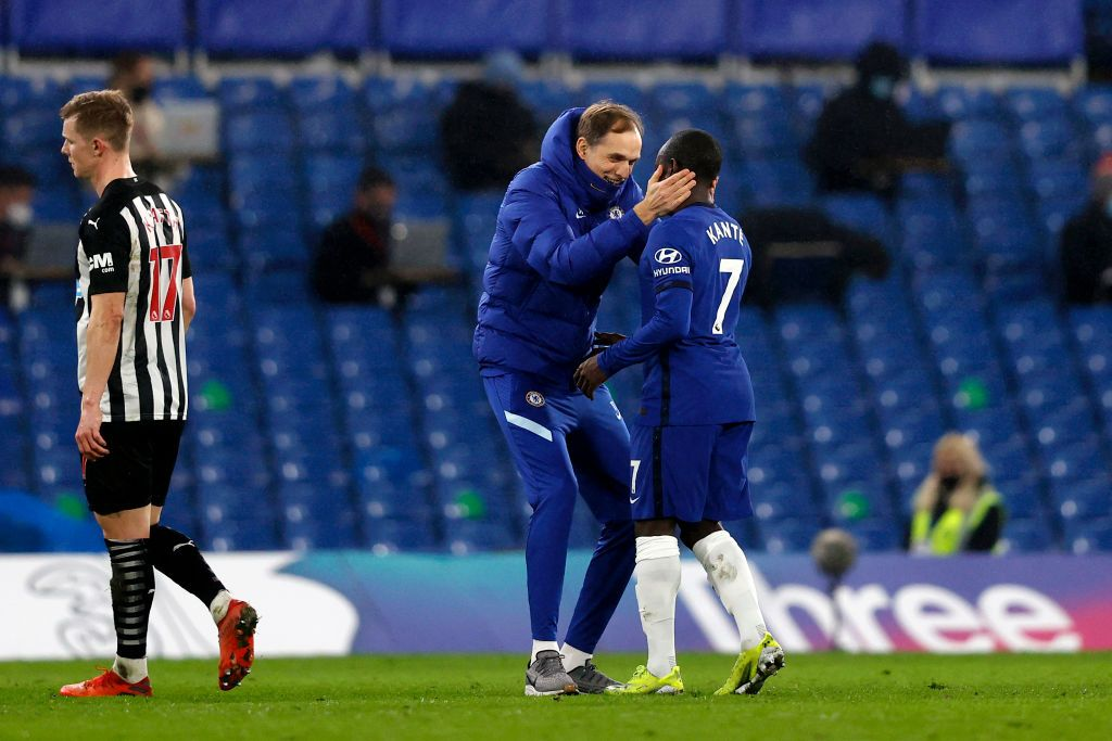 LONDON, ENGLAND - FEBRUARY 15: Thomas Tuchel, Manager of Chelsea embraces Ngolo Kante of Chelsea following the Premier League match between Chelsea and Newcastle United at Stamford Bridge on February 15, 2021 in London, England. Sporting stadiums around the UK remain under strict restrictions due to the Coronavirus Pandemic as Government social distancing laws prohibit fans inside venues resulting in games being played behind closed doors. (Photo by Adrian Dennis - Pool/Getty Images)