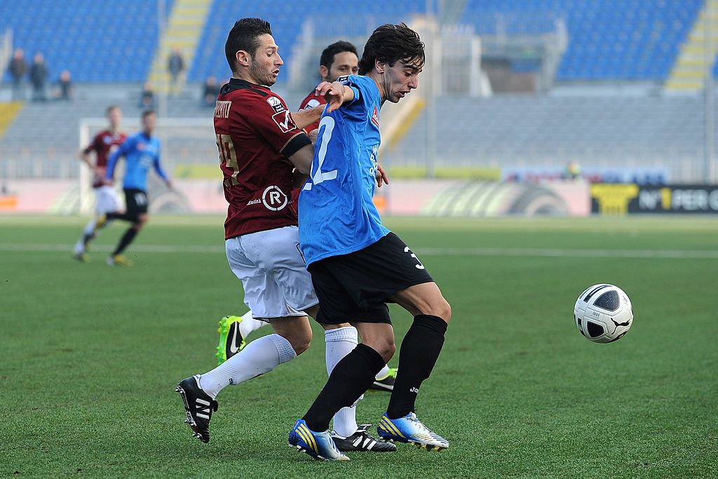 NOVARA, ITALY - MARCH 02:  Bruno Miguel Fernandes (R) of Novara Calcio is challenged by Simone Rizzato of Reggina Calcio during the Serie B match between Novara Calcio and Reggina Calcio at Silvio Piola Stadium on March 2, 2013 in Novara, Italy.  (Photo by Valerio Pennicino/Getty Images)