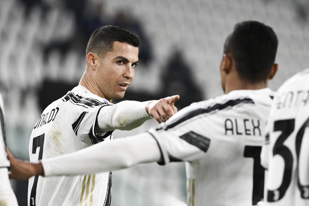Juventus' Cristiano Ronaldo, left, celebrates after scoring during the Serie A soccer match between Juventus and Crotone, at the Allianz Stadium in Turin, Italy, Monday, Feb. 22, 2021. (Marco Alpozzi/LaPresse via AP)