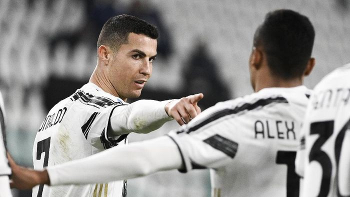 Juventus Cristiano Ronaldo, left, celebrates after scoring during the Serie A soccer match between Juventus and Crotone, at the Allianz Stadium in Turin, Italy, Monday, Feb. 22, 2021. (Marco Alpozzi/LaPresse via AP)