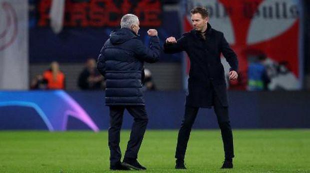 Leipzig's German headcoach Julian Nagelsmann (R) and Tottenham Hotspur's Portuguese head coach Jose Mourinho