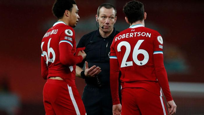 LIVERPOOL, ENGLAND - FEBRUARY 03: Trent Alexander-Arnold and Andy Robertson of Liverpool speak with Referee Kevin Friend during the Premier League match between Liverpool and Brighton & Hove Albion at Anfield on February 03, 2021 in Liverpool, England. Sporting stadiums around the UK remain under strict restrictions due to the Coronavirus Pandemic as Government social distancing laws prohibit fans inside venues resulting in games being played behind closed doors. (Photo by Phil Noble - Pool/Getty Images)
