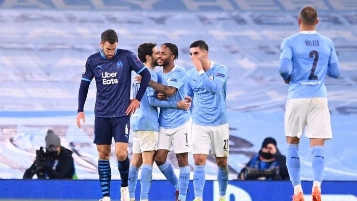 MANCHESTER, ENGLAND - DECEMBER 09: Raheem Sterling of Manchester City celebrates with teammates Bernando Silva and Ferran Torres after scoring their teams third goal during the UEFA Champions League Group C stage match between Manchester City and Olympique de Marseille at Etihad Stadium on December 09, 2020 in Manchester, England. The match will be played without fans, behind closed doors as a Covid-19 precaution. (Photo by Laurence Griffiths/Getty Images)
