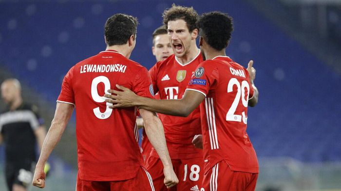 Bayerns Robert Lewandowski, left, celebrates with his teammates after scoring his sides opening goal during the Champions League round of 16 first leg soccer match between Lazio and Bayern Munich at the Olympic stadium in Rome, Tuesday, Feb. 23, 2021. (AP Photo/Gregorio Borgia)