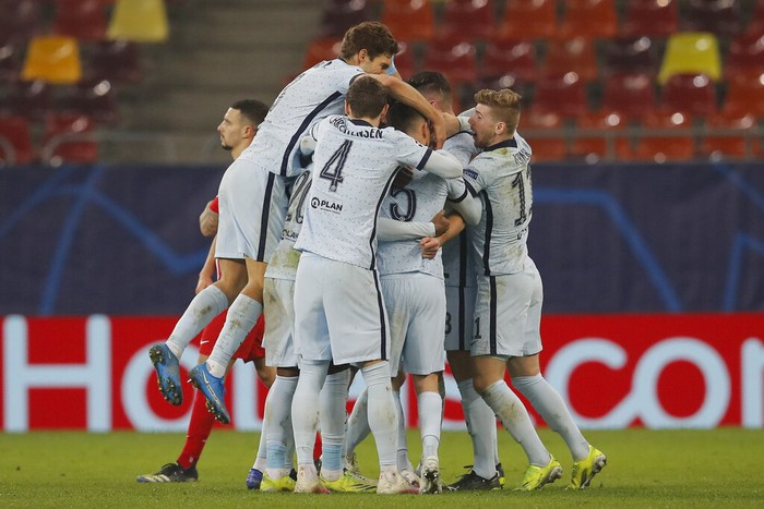 Chelseas Olivier Giroud celebrates with his teammates after scoring his sides first goal during the Champions League, round of 16, first leg soccer match between Atletico Madrid and Chelsea at the National Arena stadium in Bucharest, Romania, Tuesday, Feb. 23, 2021. (AP Photo/Vadim Ghirda)