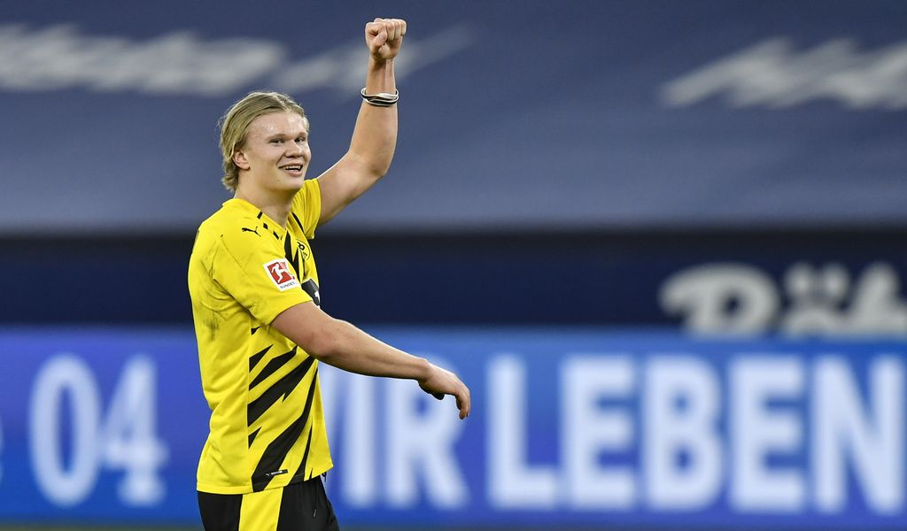 Dortmund's scorer Erling Haaland celebrates after winning the German Bundesliga soccer match between FC Schalke 04 and Borussia Dortmund in Gelsenkirchen, Germany, Saturday, Feb. 20, 2021. (AP Photo/Martin Meissner, Pool)