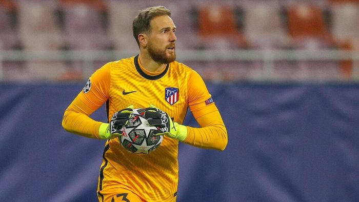 Atletico Madrids goalkeeper Jan Oblak holds the ball during the Champions League, round of 16, first leg soccer match between Atletico Madrid and Chelsea at the National Arena stadium in Bucharest, Romania, Tuesday, Feb. 23, 2021. (AP Photo/Vadim Ghirda)
