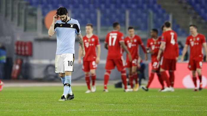Lazios Luis Alberto reacts after his teammate Lazios Francesco Acerbi scored an own goal during the Champions League round of 16 first leg soccer match between Lazio and Bayern Munich at the Olympic stadium in Rome, Tuesday, Feb. 23, 2021. (AP Photo/Gregorio Borgia)