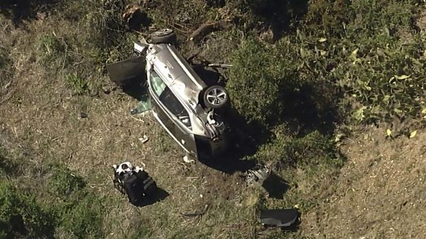 In this aerial image take from video provided by KABC-TV, a vehicle rest on its side after a rollover accident involving golfer Tiger Woods along a road in the Rancho Palos Verdes suburb of Los Angeles on Tuesday, Feb. 23, 2021. Woods had to be extricated from the vehicle with the