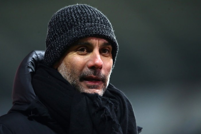 SWANSEA, WALES - FEBRUARY 10: Pep Guardiola, Manager of Manchester City reacts during a  during The Emirates FA Cup Fifth Round match between Swansea City and Manchester City at Liberty Stadium on February 10, 2021 in Swansea, Wales. Sporting stadiums around the UK remain under strict restrictions due to the Coronavirus Pandemic as Government social distancing laws prohibit fans inside venues resulting in games being played behind closed doors. (Photo by Michael Steele/Getty Images)