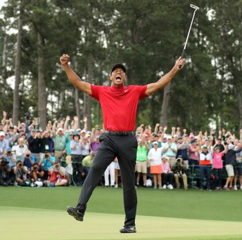 FILE PHOTO: Golf - Masters - Augusta National Golf Club - Augusta, Georgia, U.S. - April 14, 2019. Tiger Woods of the U.S. celebrates on the 18th hole to win the 2019 Masters. REUTERS/Lucy Nicholson/File Photo