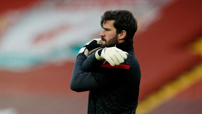 LIVERPOOL, ENGLAND - FEBRUARY 20: Alisson of Liverpool warms up prior to the Premier League match between Liverpool and Everton at Anfield on February 20, 2021 in Liverpool, England. Sporting stadiums around the UK remain under strict restrictions due to the Coronavirus Pandemic as Government social distancing laws prohibit fans inside venues resulting in games being played behind closed doors. (Photo by Phil Noble - Pool/Getty Images)