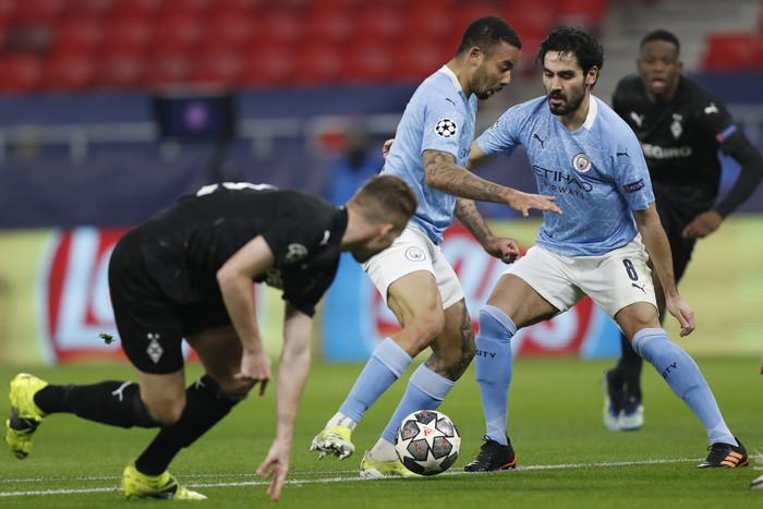 Manchester Citys Gabriel Jesus, center, in action during the Champions League round of 16 first leg soccer match between Borussia Monchengladbach and Manchester City at the Puskas Arena stadium in Budapest, Hungary, Wednesday, Feb. 24, 2021. (AP Photo/Laszlo Balogh)