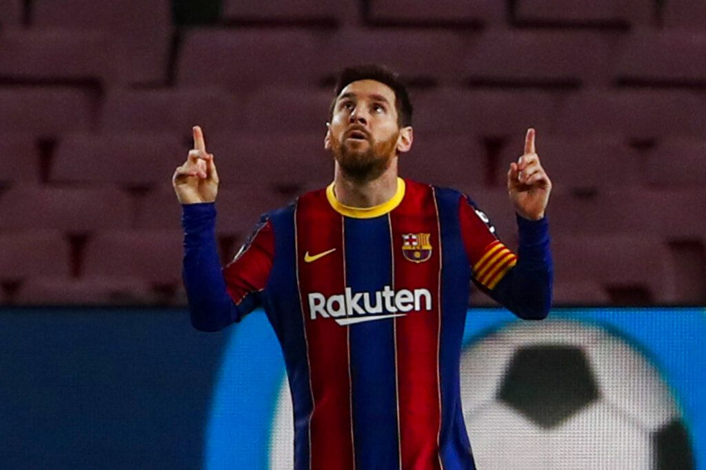 Barcelona's Lionel Messi celebrates after scoring the opening goal during the Spanish La Liga soccer match between FC Barcelona and Elche at the Camp Nou stadium in Barcelona, Spain, Wednesday, Feb. 24, 2021. (AP Photo/Joan Monfort)